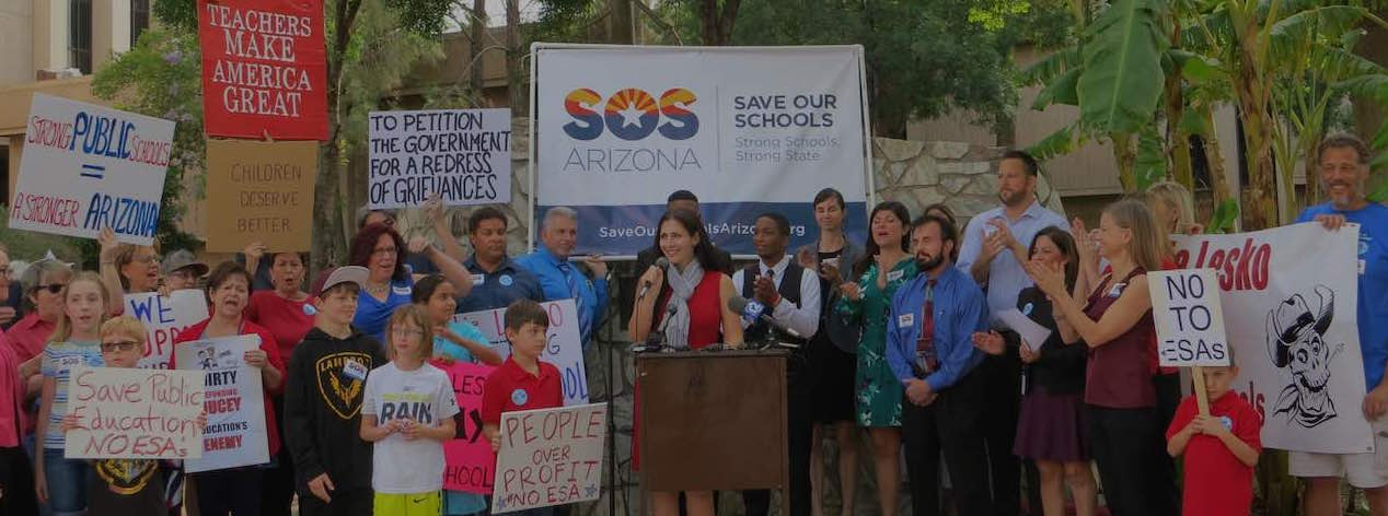 """Save Our Schools Arizona in the News :: <h3><span style=""""color: #ffffff;""""><em><a href=""""http://sosarizona.org/pages/100"""">Read local and national coverage of the fight for strong Arizona schools</a></em></span></h3> 1"""